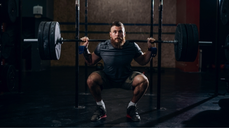Man performing back squat