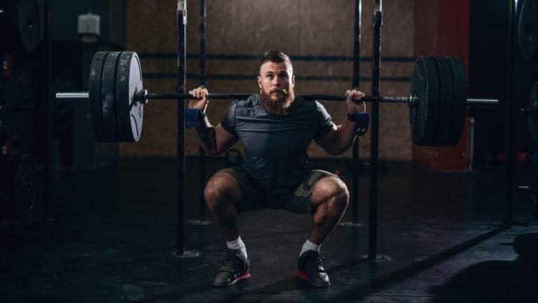 Man back-squatting
