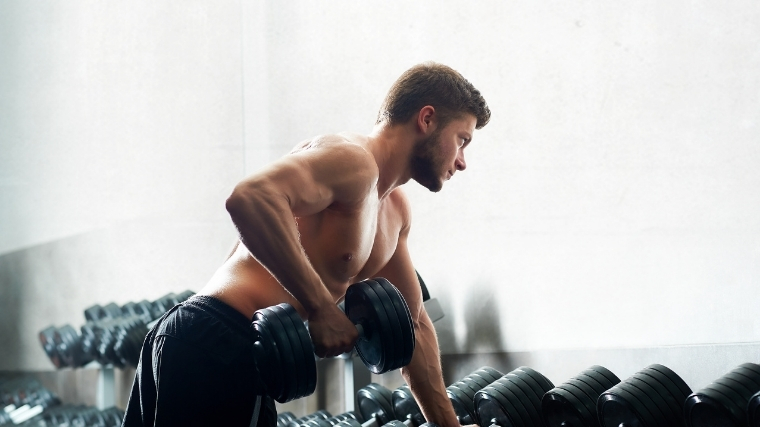 Man rowing dumbbell
