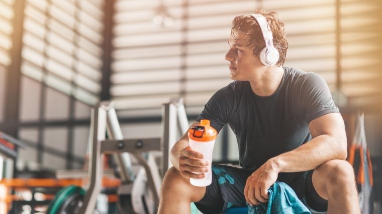 Man sitting on workout bench