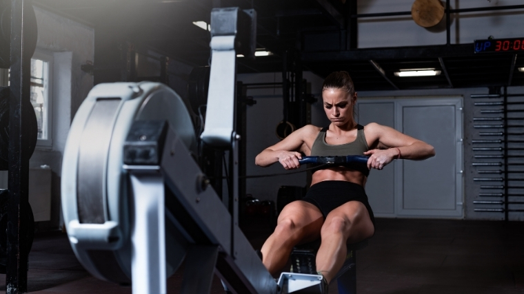 Woman rowing on an erg