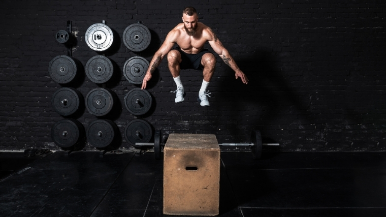 man performing box jump